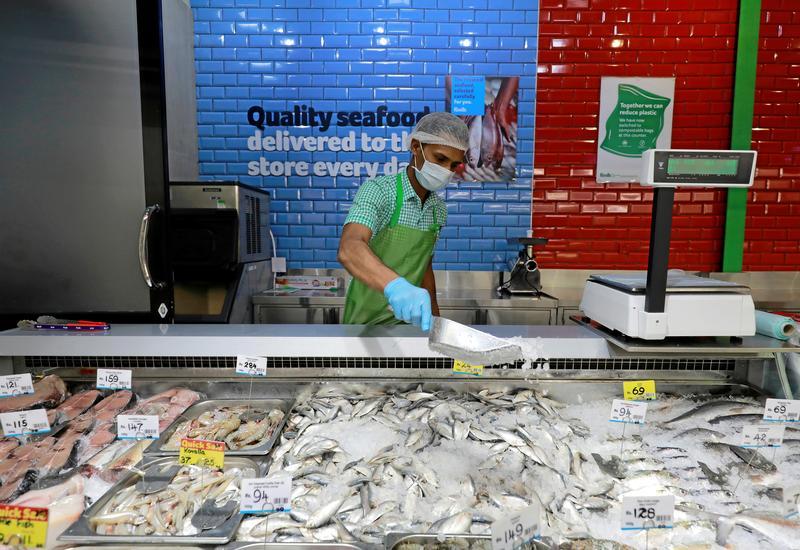 Sri Lankan lawmaker eats raw fish to promote sales hit by coronavirus – Reuters India